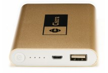 A large flat power bank with a gold coloured metal casing and black printed logo branding