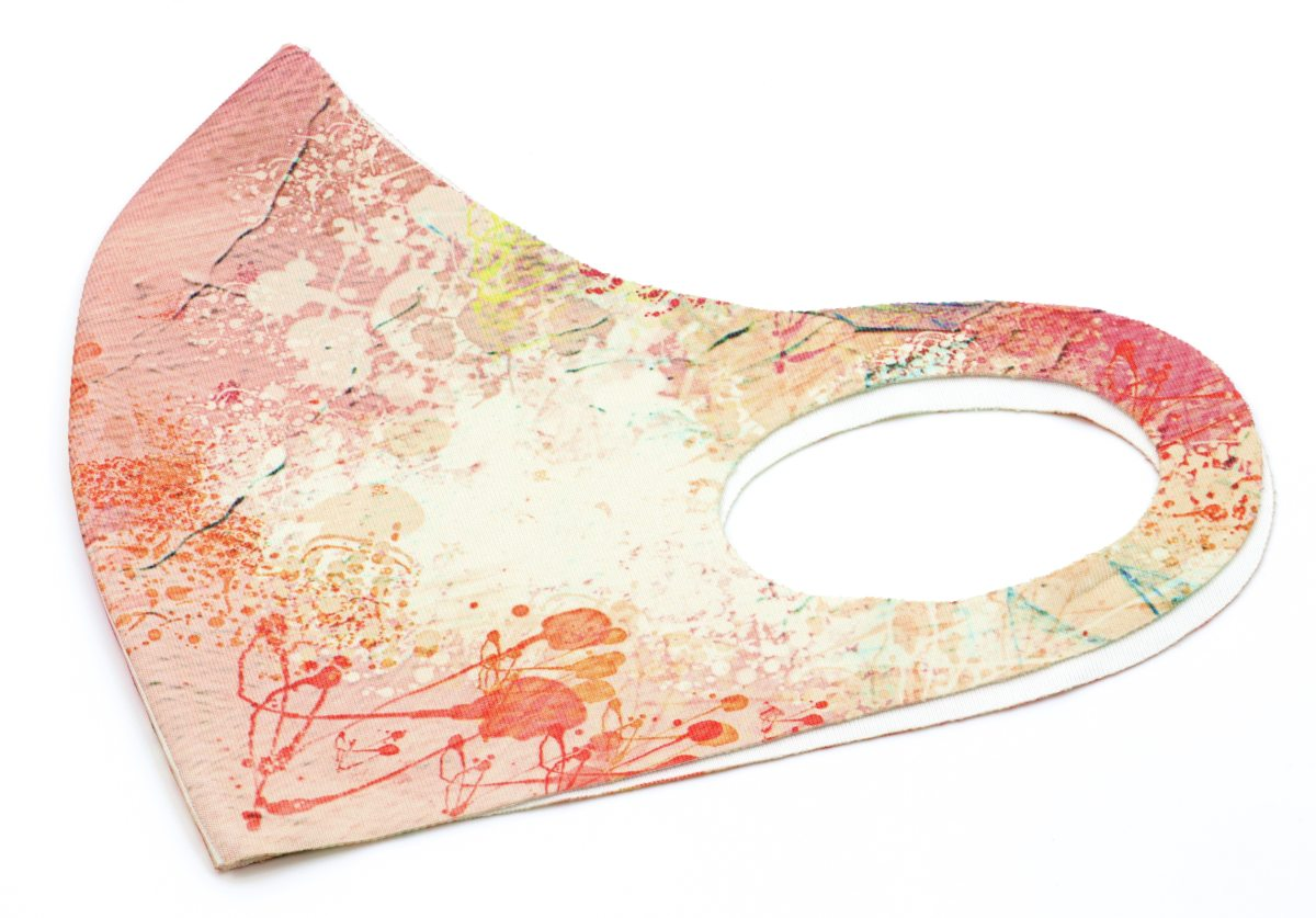 Fabric face mask colour printed with a pink abstract design