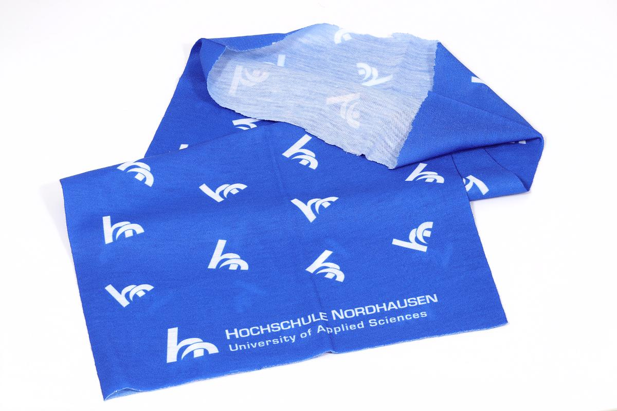 A Bandana in blue printed poylester fabric folded flat