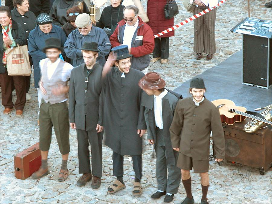Juggling street entertainers amongst a crowd at Marvao Chestnut Festival Portugal