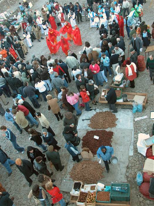 Traditional dancers and chestnut vendor at the Marvao Chestnut Festival Portugal